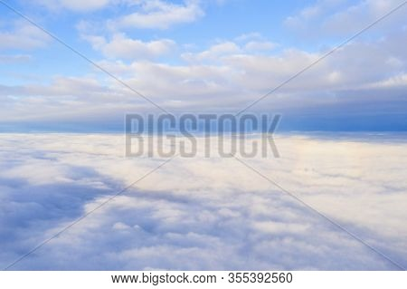 Aerial View White Clouds In Blue Sky With Solar Halo. Top View. View From Drone. Aerial Bird's Eye V