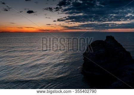 Sunset. Coastal Limestone Formations, Raukar, At Byrum At The Swedish Island Oland, The Island Of Su