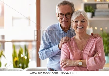 Portrait of a happy senior couple in their home