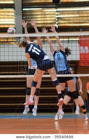 KAPOSVAR, HUNGARY - MARCH 16: Julia Karacsonyi (11) in action at the Hungarian Championship volleyball game Kaposvar (blue) vs Palota (deep blue), March 16, 2012 in Kaposvar, Hungary