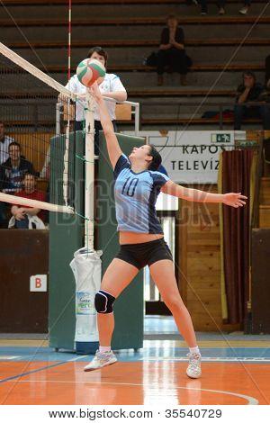 KAPOSVAR, HUNGARY - MARCH 16: Petra Kulcsar in action at the Hungarian Championship volleyball game Kaposvar (blue) vs Palota (deep blue), March 16, 2012 in Kaposvar, Hungary