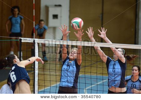 KAPOSVAR, HUNGARY - MARCH 16: Zsofia Horvath (5) in action at the Hungarian Championship volleyball game Kaposvar (blue) vs Palota (deep blue), March 16, 2012 in Kaposvar, Hungary