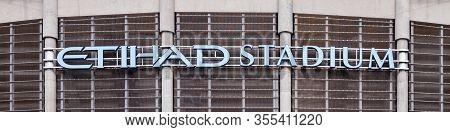 Manchester, England - May 22:  The Etihad Stadium Nameplate Adorns The Home Of Manchester City Footb