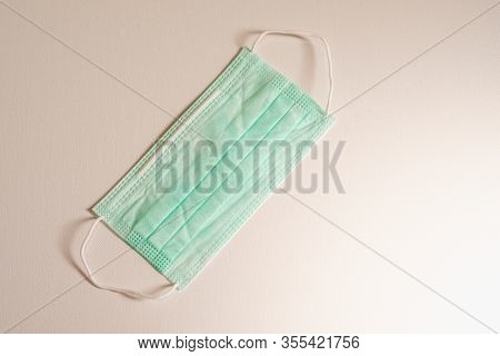 Closeup Of Surgical Medical Particulate Protective Green Mask On White Background. Using For Heathca