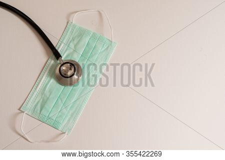 Closeup  Surgical Medical Particulate Protective Green Mask And Stethoscope For Protective Bacteria,