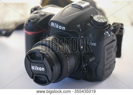 Eskisehir,turkey- March 01, 2020: Nikon D7000 Dslr Photography Camera With Nikkor  50 Mm Lens On Whi