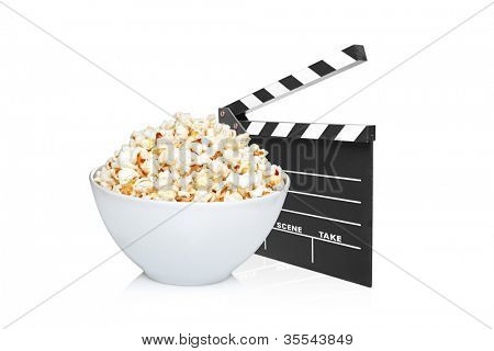 A studio shot of an open movie clap and bowl full of popcorn isolated on white background