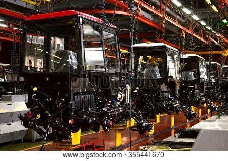 Tractor Manufacture Works. Assembly Line Inside The Agricultural Machinery Factory. Installation Of