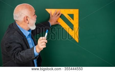 Sequential Subject. Mathematics At Board. Favorite Subject. Senior Man Teacher Use Math Triangle Too