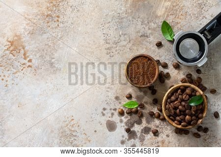 Ingredients For A Coffee Machine. Coffee Beans And Ground Powder On A Stone Countertop. Top View Fla