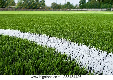 Artificial Green Grass With White Line On The Football Field As Background