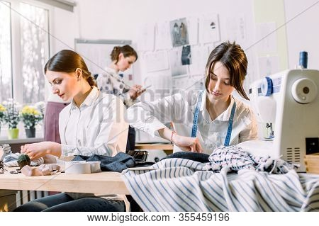 Portrait Of Young Fashion Dressmakers Women At Work. Dressmaker, Tailor, Fashion And Showroom Concep