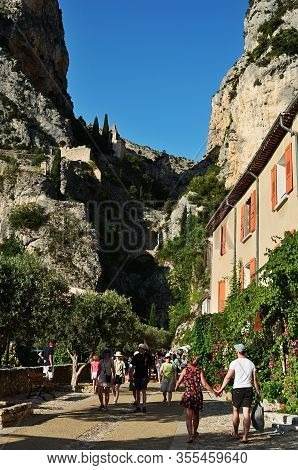 Moustiers Sainte Marie, France - Jul 18, 2014: Tourists On The Narrow Street Of The Beautiful Mediev