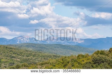 Crimean Mountains At Sunny Summer Day Under Cloudy Sky, Rural Summer Landscape Photo Background