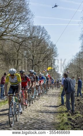 Wallers,france - April 12,2015: The Peloton Riding On The Famous Cobblestone Road From The Forest Of