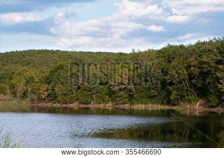Coastal Landscape With Forest And Small Lake In Crimean Mountains At Sunny Summer Day Under Cloudy S