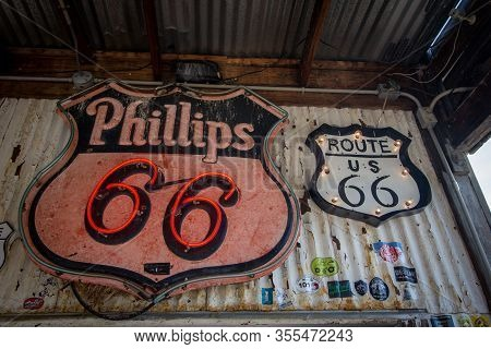 Hackberry, Arizona, Usa - February 17, 2020: Close Up Of Retro Neon Phillips 66 And Route 66 Signs.