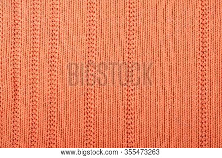 Sweater Or Scarf Fabric Texture Large Knitting. Knitted Jersey Background With A Relief Pattern. Bra