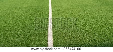 Artificial Green Grass And White Border Lines. Artificial Turf For Soccer Field. Football Field In A