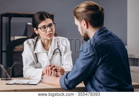 Sympathetic Female Doctor Cheering Her Patient Up
