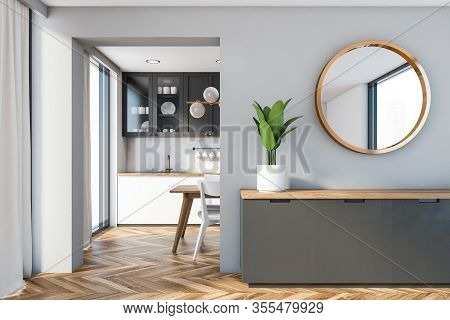 Cabinet And Mirror In Gray Dining Room