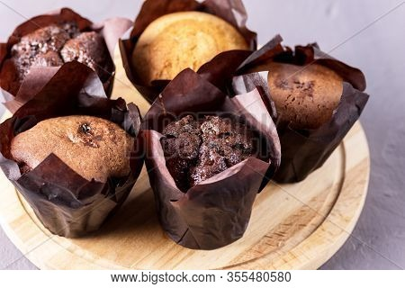 Tasty Chocolate Muffins Decorated With Berries On Old Wooden Tray Gray Background Dessert For Tea Or