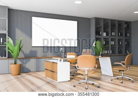 Corner Of Modern Ceo Office With Gray Walls, Wooden Floor, Massive Computer Table With Leather Chair