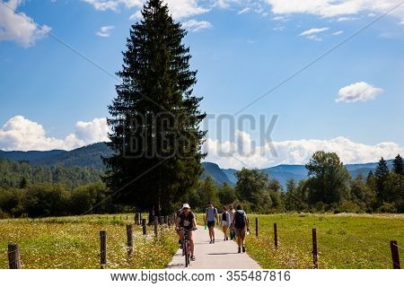 Bohinj, Slovenia - August, 04: Friends On Cycle Ride In Countryside Track In Bohinj On August 04, 20