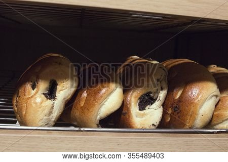Buns With Poppy Seeds On The Counter Of A Bakery Store