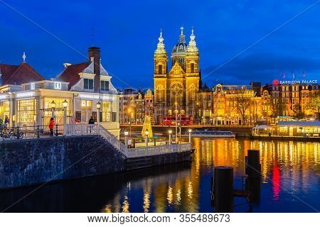View From Central Station To Basilica Of Saint Nicholas, Amsterdam, Netherlands, At Night