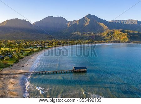 Aerial Panoramic Image At Sunrise Off The Coast Over Hanalei Bay And Pier On Hawaiian Island Of Kaua