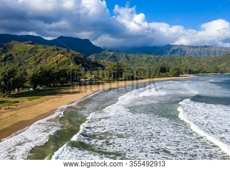 Aerial Panoramic Image At Sunrise Off The Coast Over Hanalei Bay And Waioli Beach Park On Hawaiian I