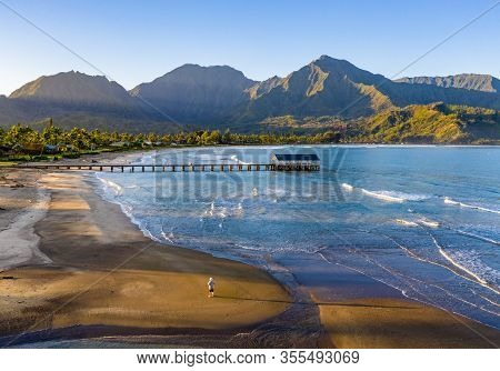 Aerial Image At Sunrise Off The Coast Over Hanalei Bay And Pier On Hawaiian Island Of Kauai With A M