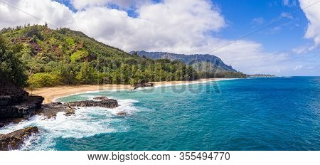 Aerial Panoramic Image Off The Coast Over Lumahai Beach On Hawaiian Island Of Kauai With Na Pali Mou