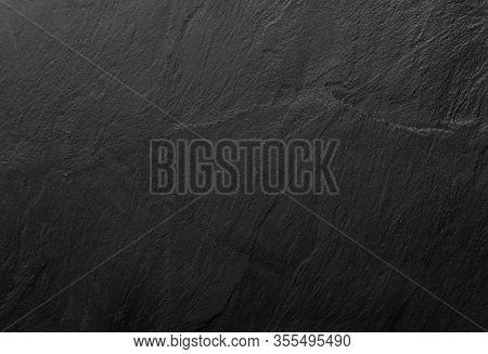 Black Slate Texture In Which The Grain Of The Mineral Can Be Seen. Empty Table For Cheeses And Other