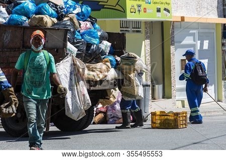 March 7, 2020, Ocoa, Dominican Republic. Image Of A Garbage Truck And Workers Cleaning The Street Of