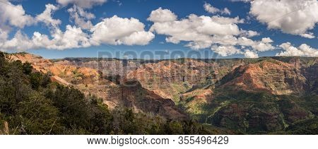 Broad Panorama Of The Red Rocks Of Waimea Canyon From The Iliau Nature Trail On Kauai In Hawaii