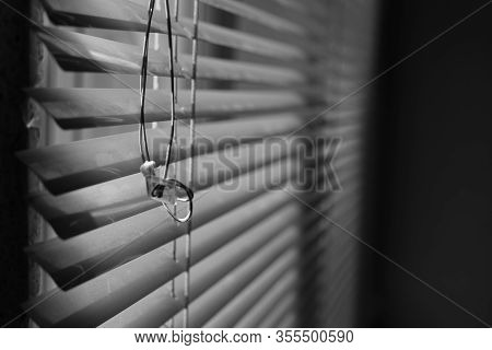 Horizontal Metal Jalousie With Old Rope. Blinds Background. Bw Photo
