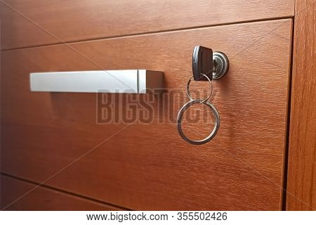 The Desk Drawer Is Locked. Key Table In The Keyhole. Concept: Commercial Secret, Secret, Confidentia