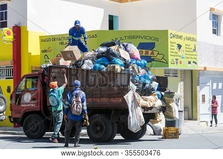 March 7, 2020, Ocoa, Dominican Republic. Dramatic Image Of Image Of A Garbage Truck And Workers Clea