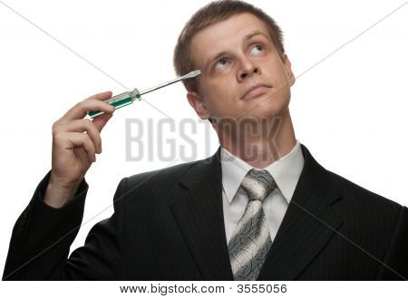 Businessman With A Screwdriver Thinking Or Perplexed