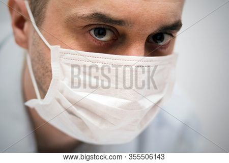 Doctor wearing protection face mask against coronavirus