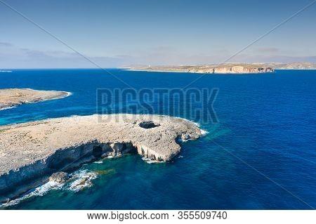 Big Natural Hole In The Rock. Coral Lagoon. Malta Island