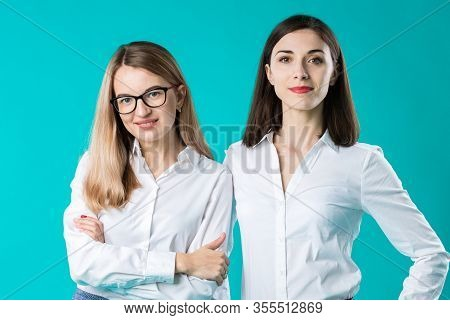 Portrait Of Two Women In Office Clothes. Cute Attractive Businesswomen. Team Of Two Smiling Business