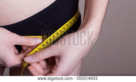 Girl Measures Her Volumes With A Centimeter