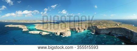 Aerial Drone Panorama Photo - The Famous Blue Lagoon In The Mediterranean Sea. Comino Island, Malta.