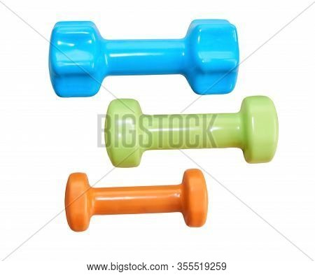Three Small Rubberized Dumbbells Of Different Weights Isolated On A White Background