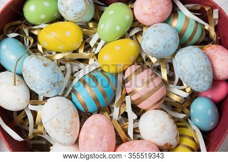 Multi Colored Easter Eggs. Happy Easter. Close Up Of Colorful Easter Eggs In Basket.