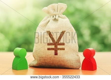 Yen Yuan Money Bag And A Deal Between Two Persons. Business Lending, Leasing. Trade Agreement. Negot
