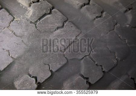 Texture Of An Old Car Tire. Worn Tire Tread. The Danger Of Using An Old Car Tire With A Shallow Trea